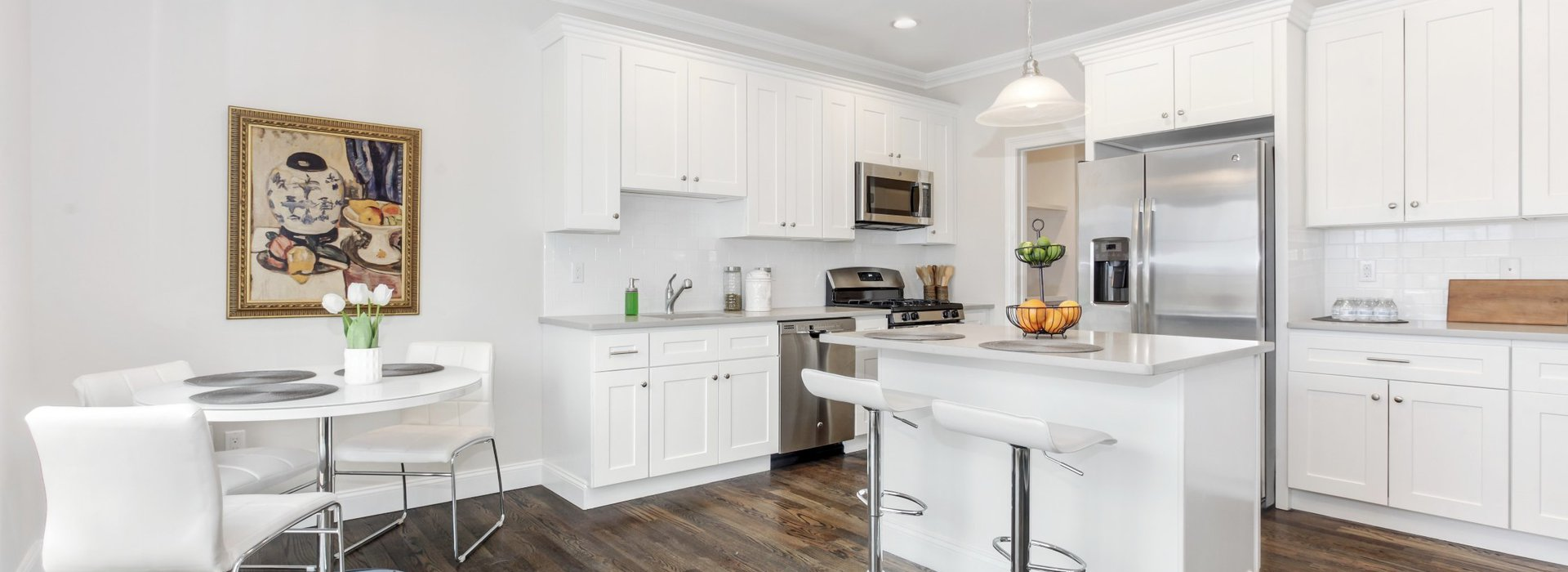 view of townhome kitchen with white marble appliances
