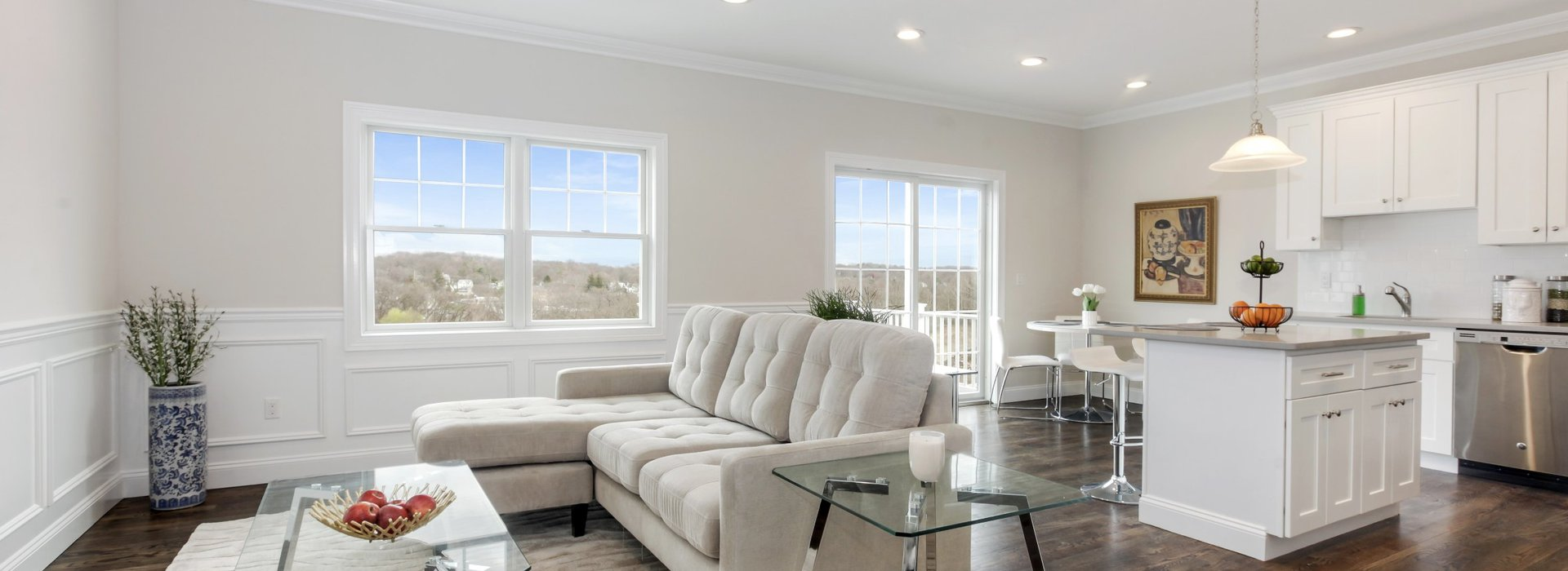 beautiful large white living room with white furniture